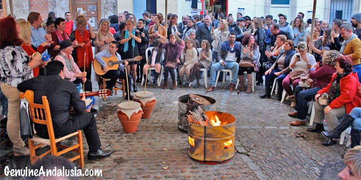 People playing guitar and singing in a zambomba in Jerez