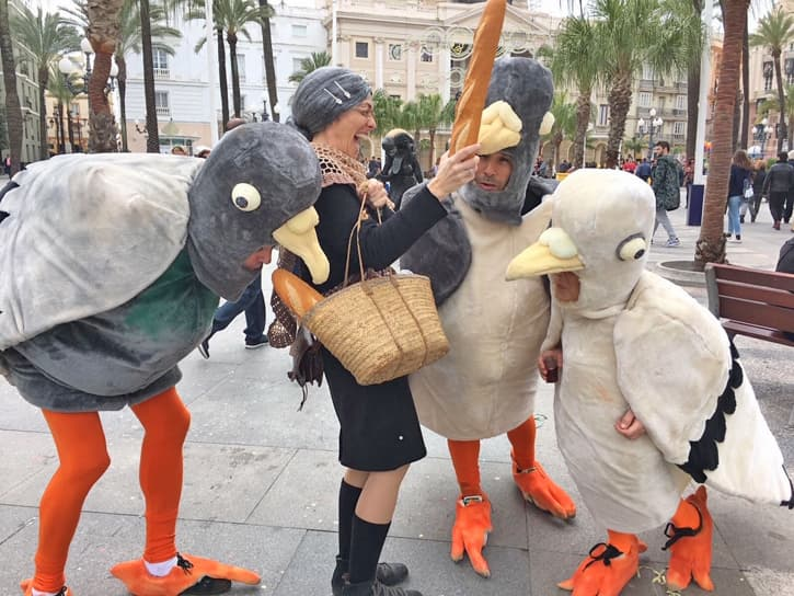 Locals in costumes at the Carnival of Cadiz