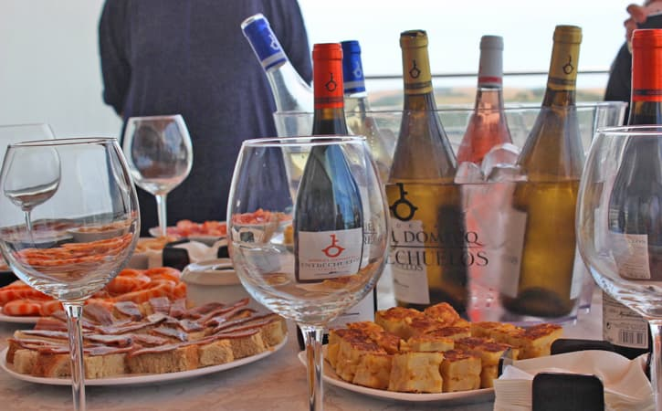 A table with food and wines from Bodega Miguel Domecq