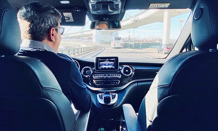 A man driving a luxury Mercedes vehicle. Spain trip planning services