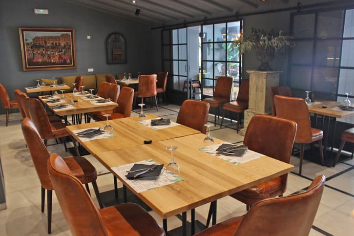 tables and chairs in the dining areas of restaurant AQ35 in Jerez