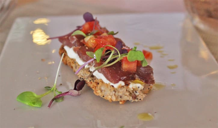 a plate with a toast of half cured on top