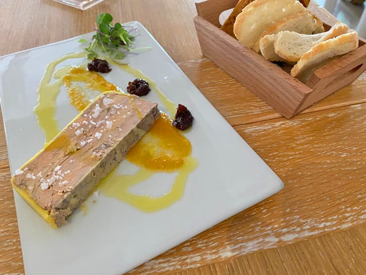 A plate with a portion of homemade foie gras