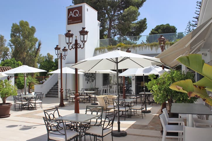 Tables and chairs on an outdoor restaurant setting in Jerez