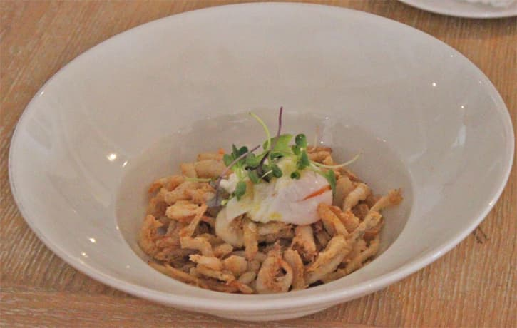A plate of fried prawns and squid strips with egg at Restaurante el Embarcadero, Rota Spain